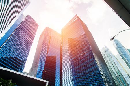 Photo pour Modern business skyscrapers, high-rise buildings, architecture raising to the sky, sun. Concepts of financial, economics, future etc. - image libre de droit