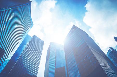 Foto de Modern business skyscrapers, high-rise buildings, architecture raising to the sky, sun. Concepts of financial, economics, future etc. - Imagen libre de derechos