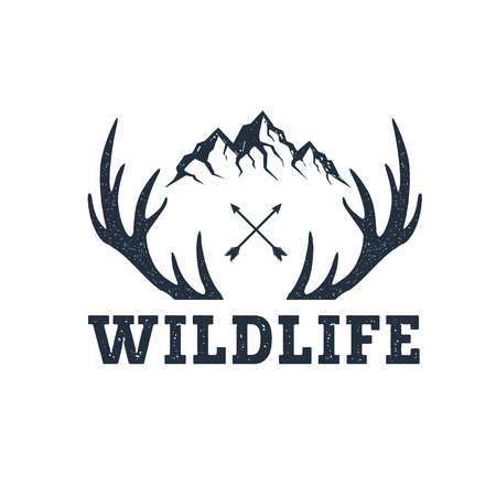 Ilustración de Hand drawn inspirational label with mountains and antlers textured vector illustrations and Wildlife lettering. - Imagen libre de derechos