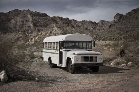 Old white school bus abandoned in a Cactus field, Nelson, Nevada, USA