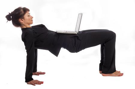 Foto de Multi tasking woman in yoga pose  Isolated on white - Imagen libre de derechos