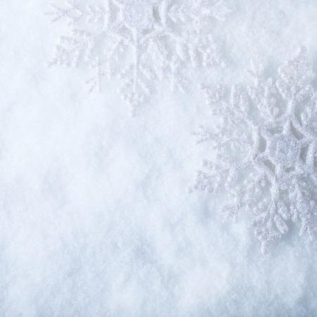 Foto de Two beautiful sparkling vintage snowflakes on a white frost snow background. - Imagen libre de derechos