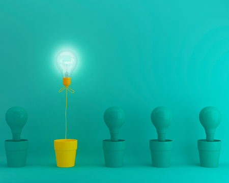 Foto de Outstanding yellow light bulbs with glowing in flowerpot one different idea from light bulbs the others on green pastel background, Minimal concept idea. - Imagen libre de derechos