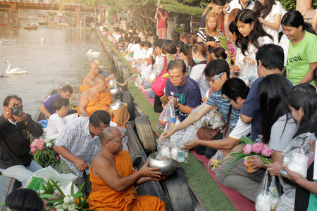 Photo for Bangkok ,Thailand , Mar 11,2018 ,Monks are in a boat trip to recieve the food and flowers from many Buddhist on Saen-Saep canal in morning. - Royalty Free Image