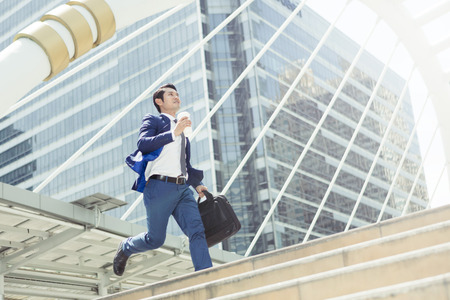 Photo for Business man run to work in rush hour - Royalty Free Image