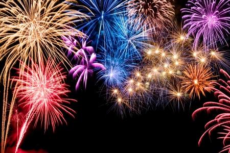 Photo pour Gorgeous multi-colored fireworks display on black background, with copyspace - image libre de droit