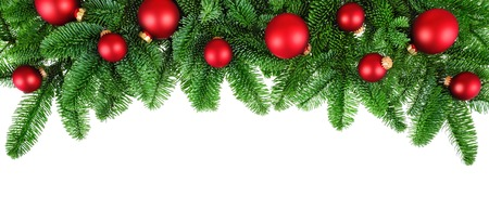Photo pour Studio isolated lush fir twigs with red baubles as a bow-shaped border on pure white background - image libre de droit