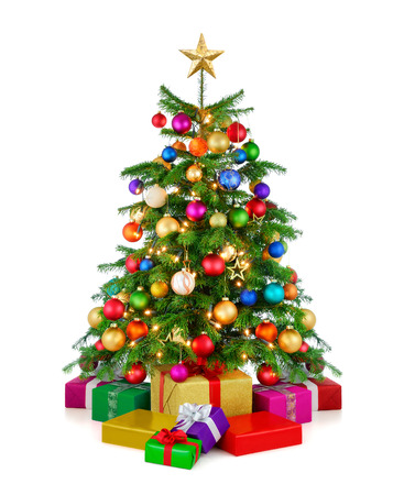Foto de Joyful studio shot of a colorful lush Christmas tree shining in vibrant colors, with gold star on top and gift boxes arranged in front of it, isolated on pure white background - Imagen libre de derechos