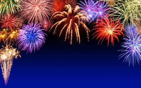 Foto de Gorgeous multi-colored fireworks display on dark blue night sky, with copyspace - Imagen libre de derechos