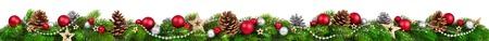 Foto de Extra wide Christmas border with fir branches, red and silver baubles, pine cones and other ornaments, isolated on white - Imagen libre de derechos