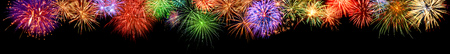 Photo pour Gorgeous multi-colored fireworks as an extra wide panoramic border on black background, ideal for New Year or other celebration events - image libre de droit