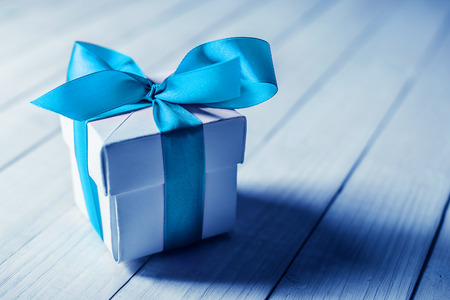 Photo for single gift box on wood table - Royalty Free Image