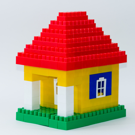 Photo for colorful house made of children constructor on abstract background - Royalty Free Image