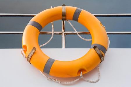 Orange life buoy in boat