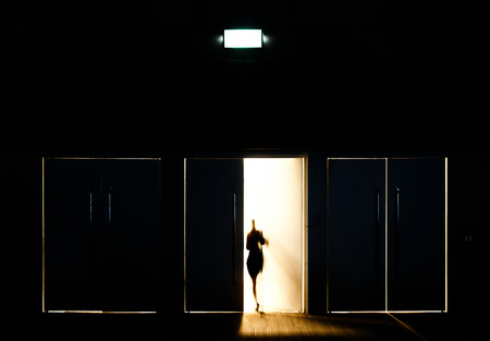 Photo for Door opened with motion blur of a man and light coming through the space - Royalty Free Image