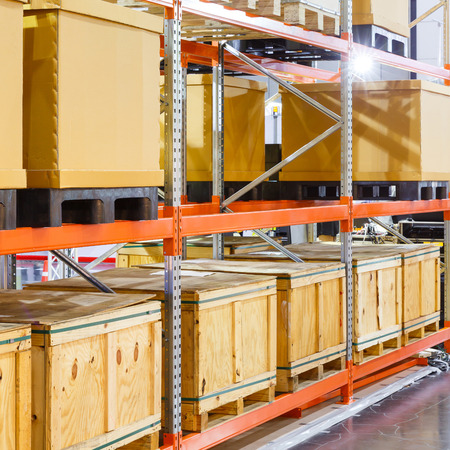 Photo for Close up paper and wooden cargo box on steel shelf system in warehouse - Royalty Free Image