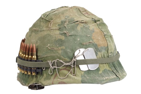Foto de US Army helmet with camouflage cover and ammo belt and dog tags - Vietnam war period - Imagen libre de derechos