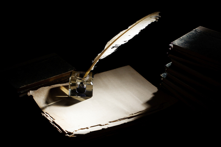 Photo for Old fountain pen, books and inkwell on a black background - Royalty Free Image