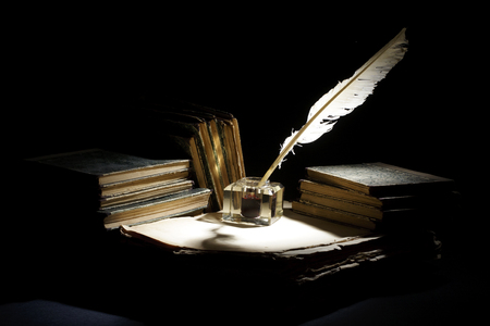 Photo for Vintage concept. Old fountain pen, books and inkwell on a black background - Royalty Free Image