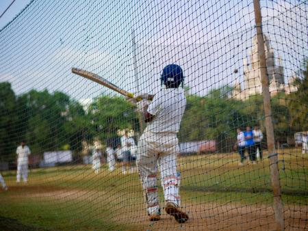 Photo for Mumbai, India - April 21, 2018: Unidentified boy practicing batting to improve cricketing skills at Mumbai grounds - Royalty Free Image