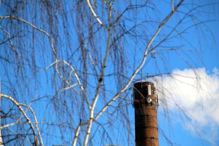 Foto de In winter, smoke comes out of the chimney when heating buildings - Imagen libre de derechos