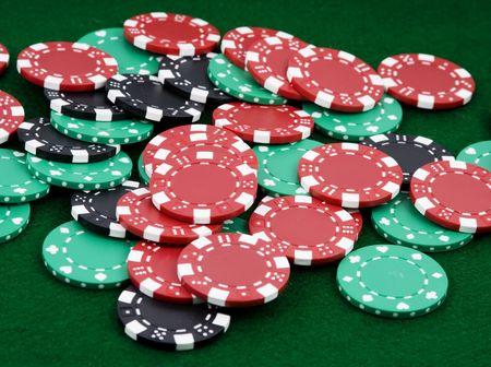 pile of betting chips winner payout on green felt