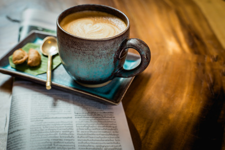 Photo for hot latte art coffee with newspaper on wooden table, vintage and retro style. - Royalty Free Image