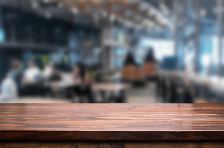 Photo for Selected focus empty brown wooden table and Coffee shop or restaurant blur background with bokeh image. for your photomontage or product display - Royalty Free Image