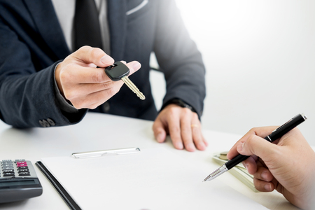 Photo for Businessman giving end key to customer after good deal agreement. while loan agreement being approved and calculator, Buy house concept - Royalty Free Image