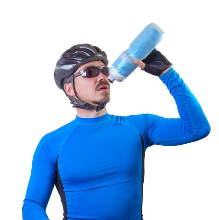 Adult bicyclist drinking from water bottle.