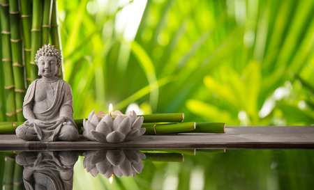 Photo for Buddha in meditation with burning candle - Royalty Free Image