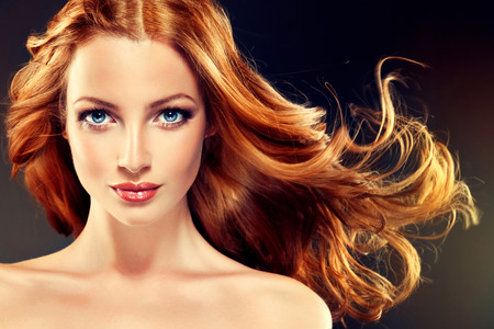 Photo pour Beautiful model with long curly red hair .  Styling hairstyles curls - image libre de droit