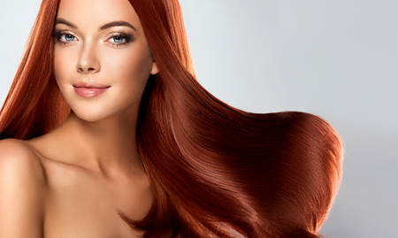Foto de Beautiful model girl with shiny brown straight long hair . Care and hair products - Imagen libre de derechos