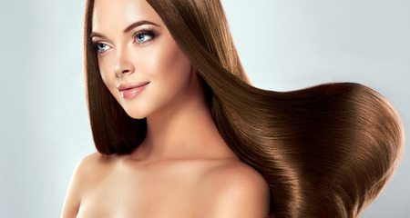 Photo for Beautiful model girl with shiny brown straight long hair . Care and hair products - Royalty Free Image