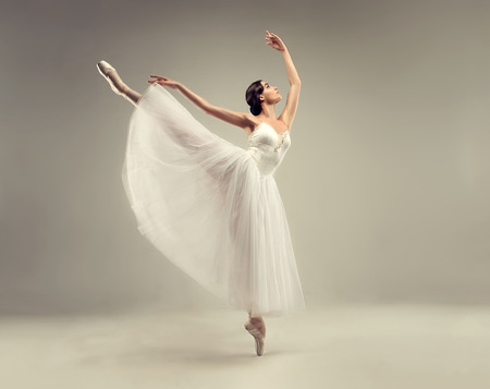 Foto de Ballerina. Young graceful woman ballet dancer, dressed in classic, white Chopin tutu, and professional ballet shoes  is demonstrating dancing skill. Beauty of classic ballet. - Imagen libre de derechos