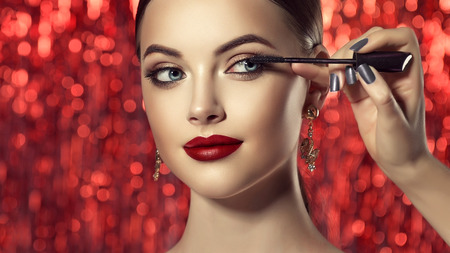 Photo pour Make up artist is working with face of perfect model. Cosmetic and make up. - image libre de droit