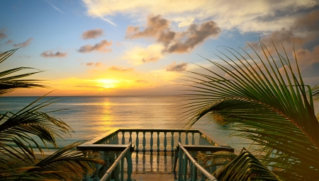 Foto de The view from the terraces of the beautiful sunset on the beach - Imagen libre de derechos