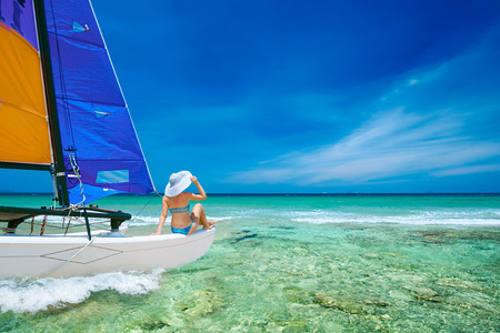 Photo pour Young woman traveling by boat among the islands. Travel to Asia, happiness emotion, summer holiday concept - image libre de droit