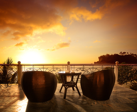 Photo for Terrace lounge with rattan armchairs and seaview in a luxury resort . Summer holiday concept - Royalty Free Image