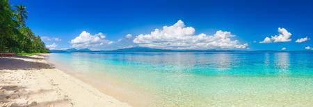 Foto de Panoramic view of a tropical beach against the backdrop of the island of Sulawesi. Indonesia - Imagen libre de derechos