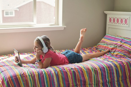 Photo for Young girl with headphones and tablet - Royalty Free Image