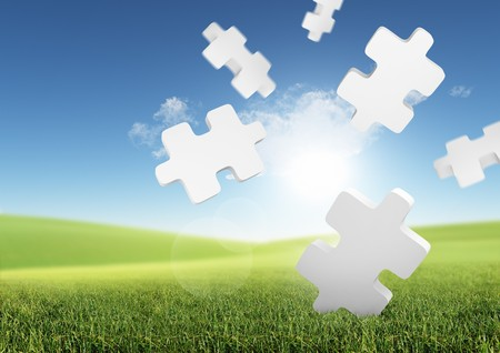 Business Solutions. Conceptual image with falling puzzle pieces in a green field.