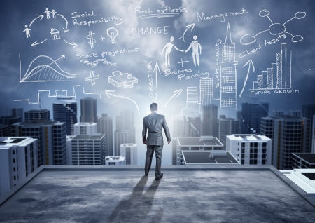 Foto de Business Ideas - conceptual. A businessman watching the city with big ideas. - Imagen libre de derechos