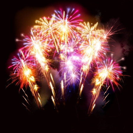 Photo pour Colourful golden and pink fireworks display for celebrations. - image libre de droit