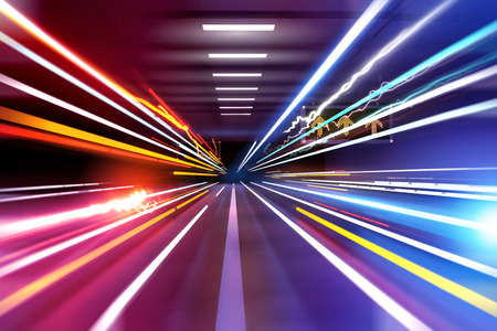 Foto per traffic light trails through an urban setting. Super fast! - Immagine Royalty Free