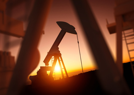 Foto de Oil and Energy Industry. A field of oil pumps against a sunset. Oil prices, energy and economic commodities. - Imagen libre de derechos