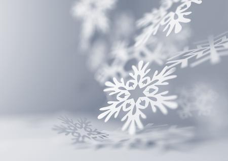 Foto de Falling Snowflakes. Paper craft snowflakes close up illustration of falling snowflakes. Christmas winter background. - Imagen libre de derechos