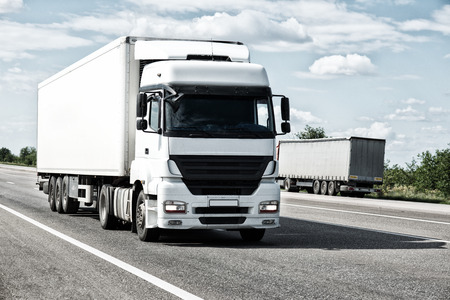 Photo pour White truck on road. Cargo transportation - image libre de droit