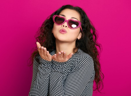 Photo for beautiful girl glamour portrait on pink make flying kiss - Royalty Free Image