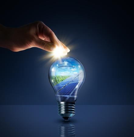 Foto de invest in solar energy - concept - sun in bulb - piggybank  - Imagen libre de derechos